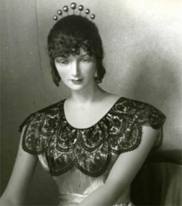 Mannequin wearing lace headpiece and collar